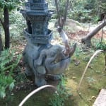 stone elephant along path in Tokyo garden
